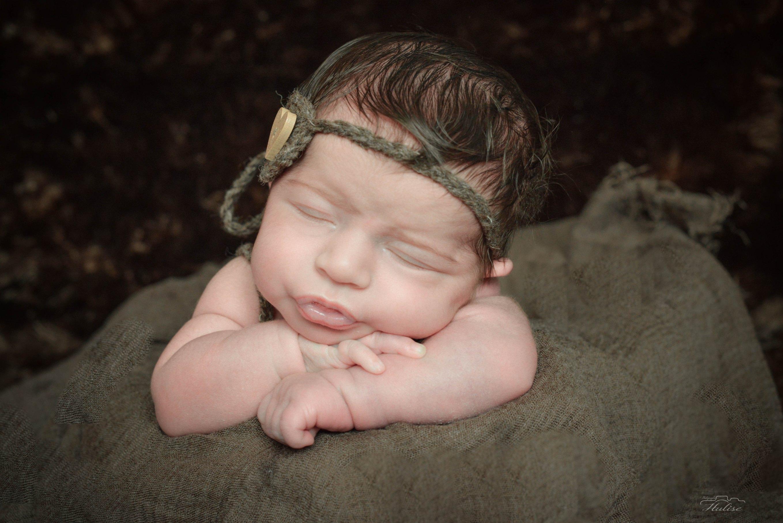 Nouveau né pris en photographie a sa naissance par la photographe